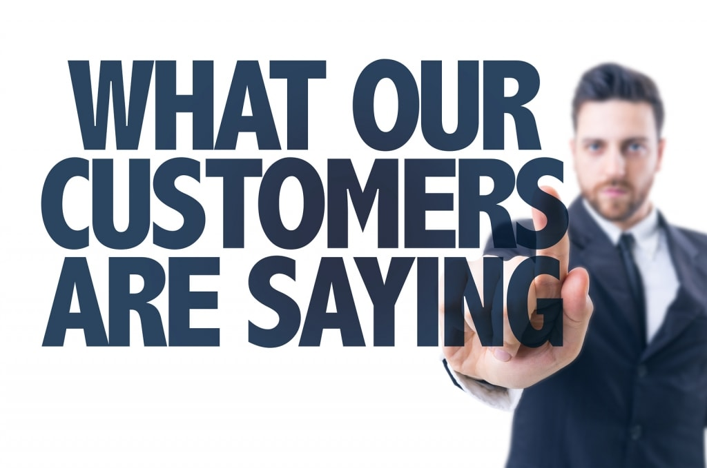 Business man pointing the text: What Our Customers Are Saying