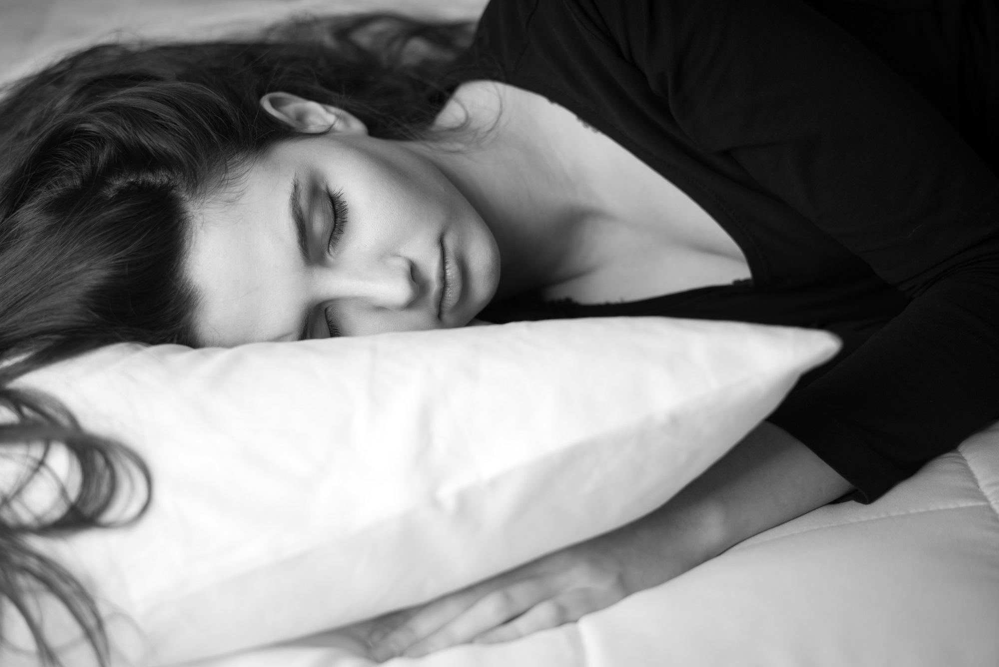 woman sleeping on the bed at home