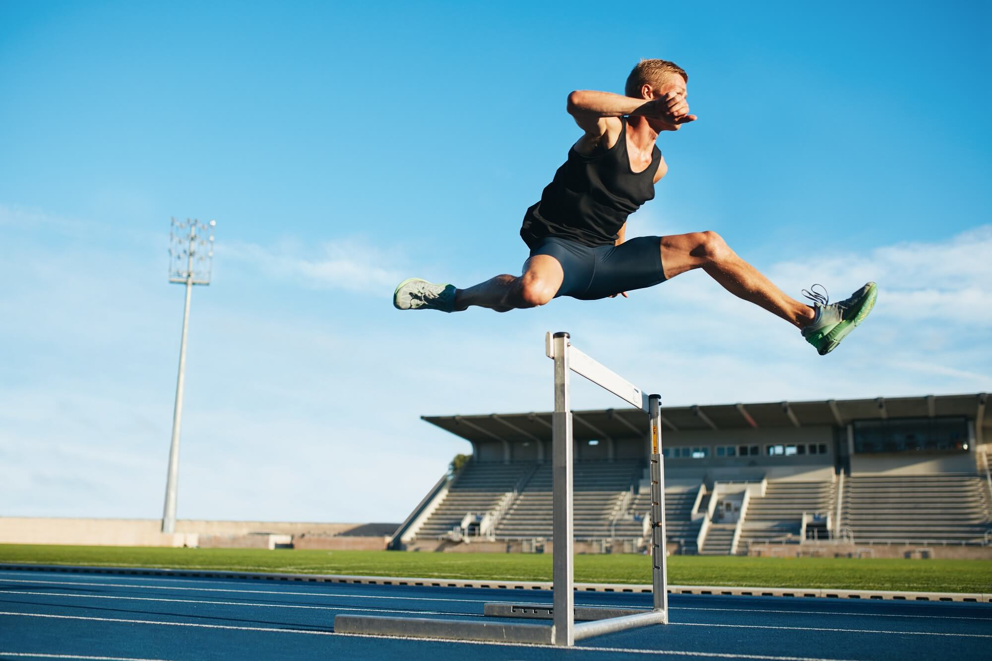Man jumping over a hurdle