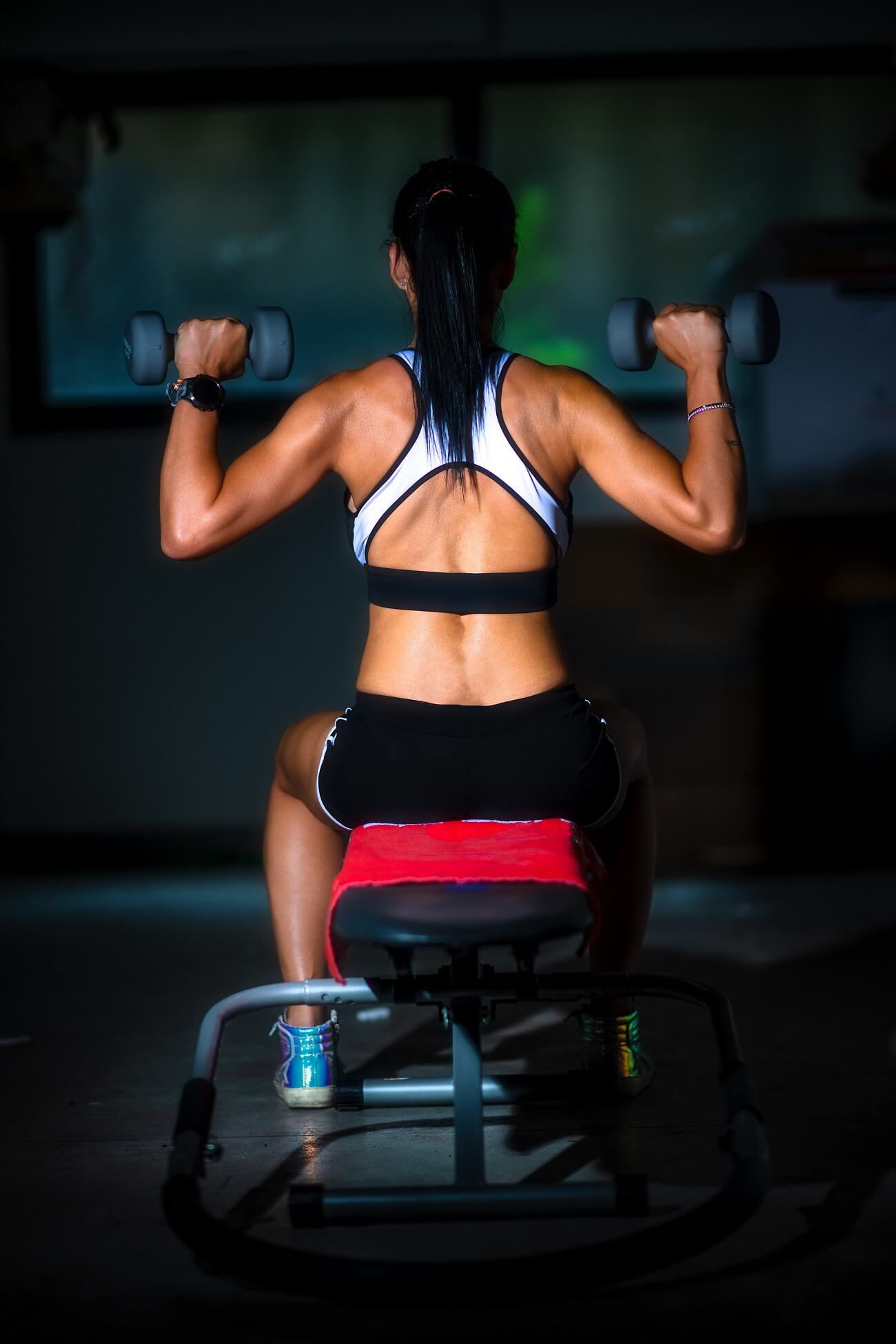 A girl on the bench and weights