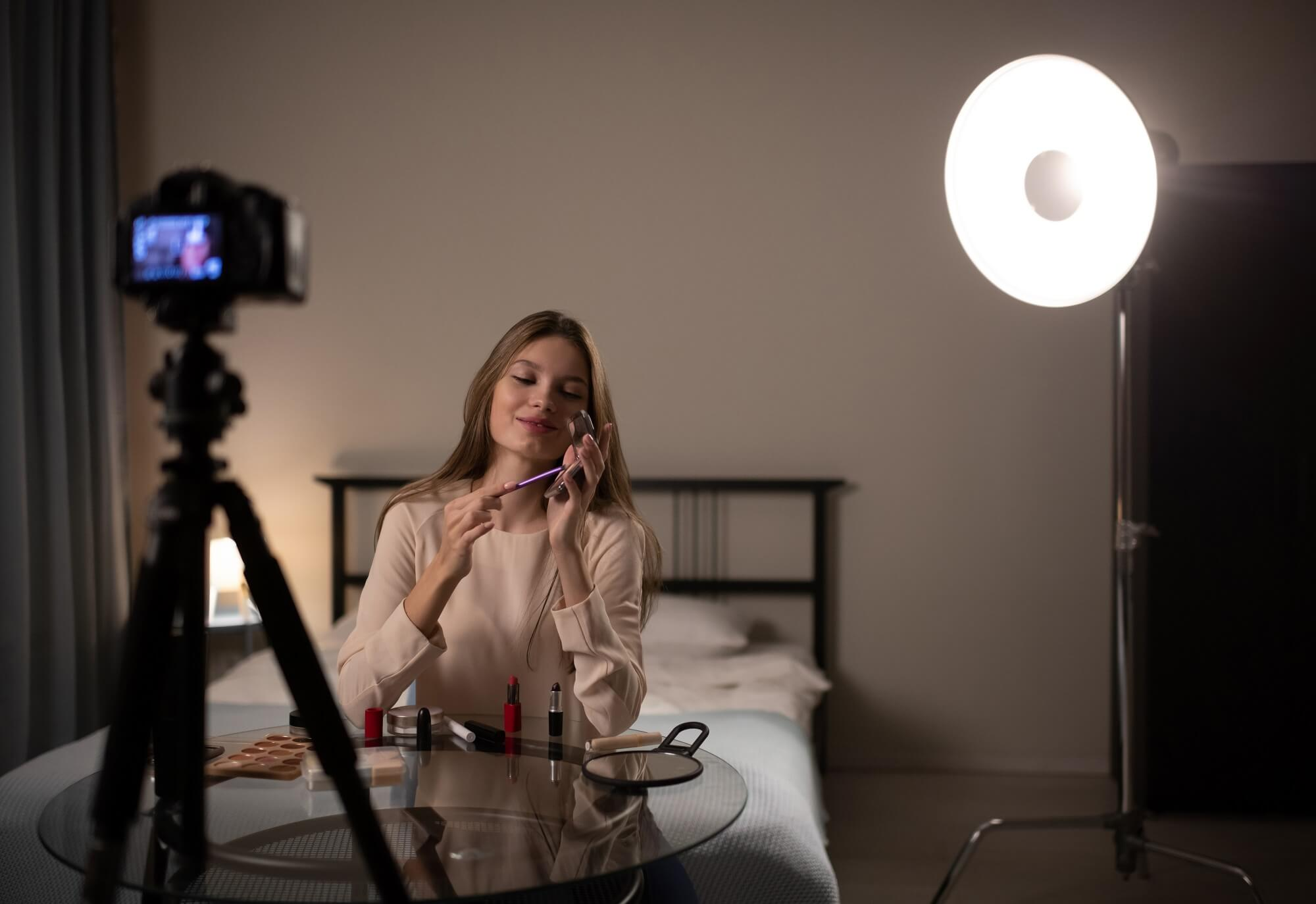 young woman recording tutorial video