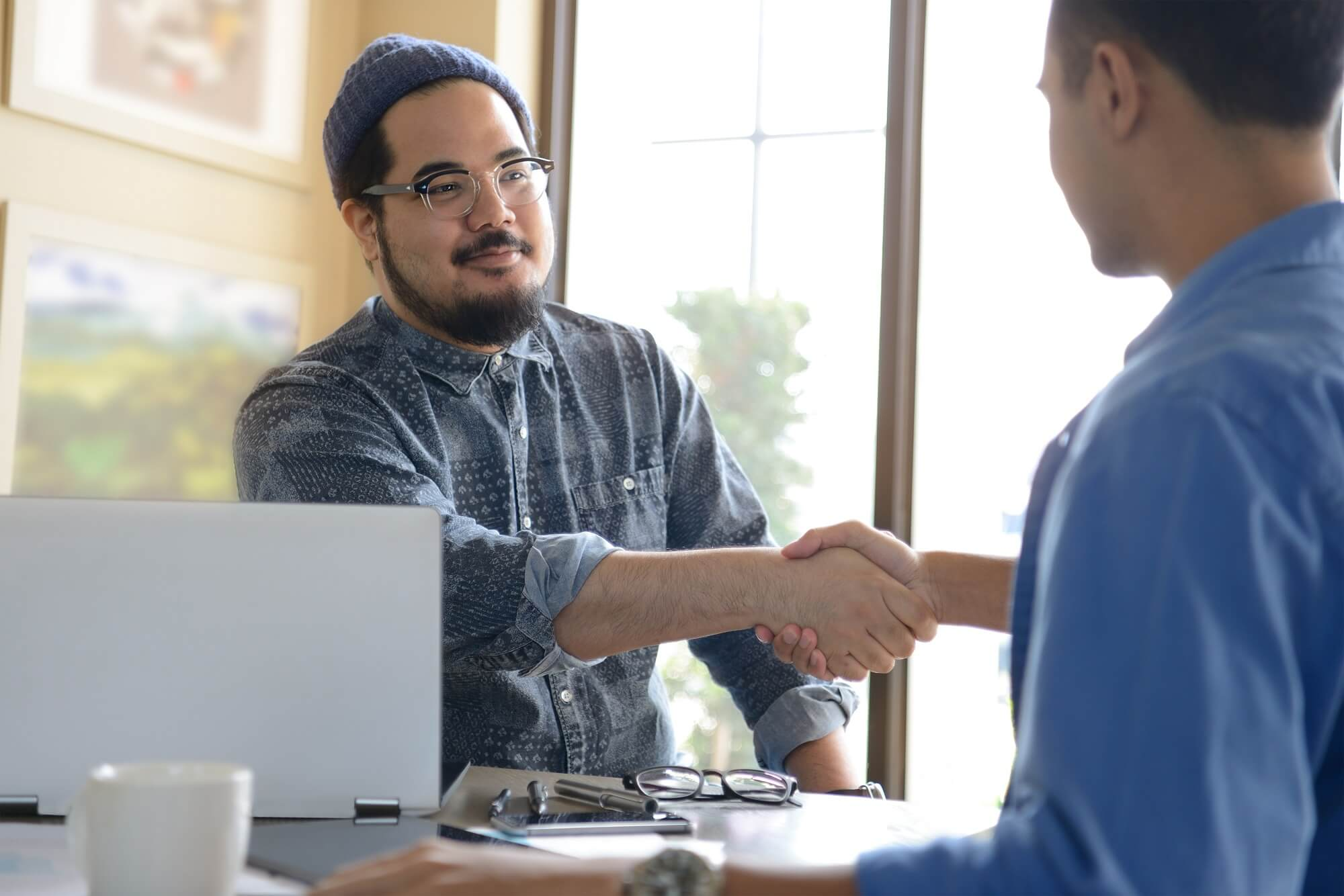 businessman shaking hands with co brand representative