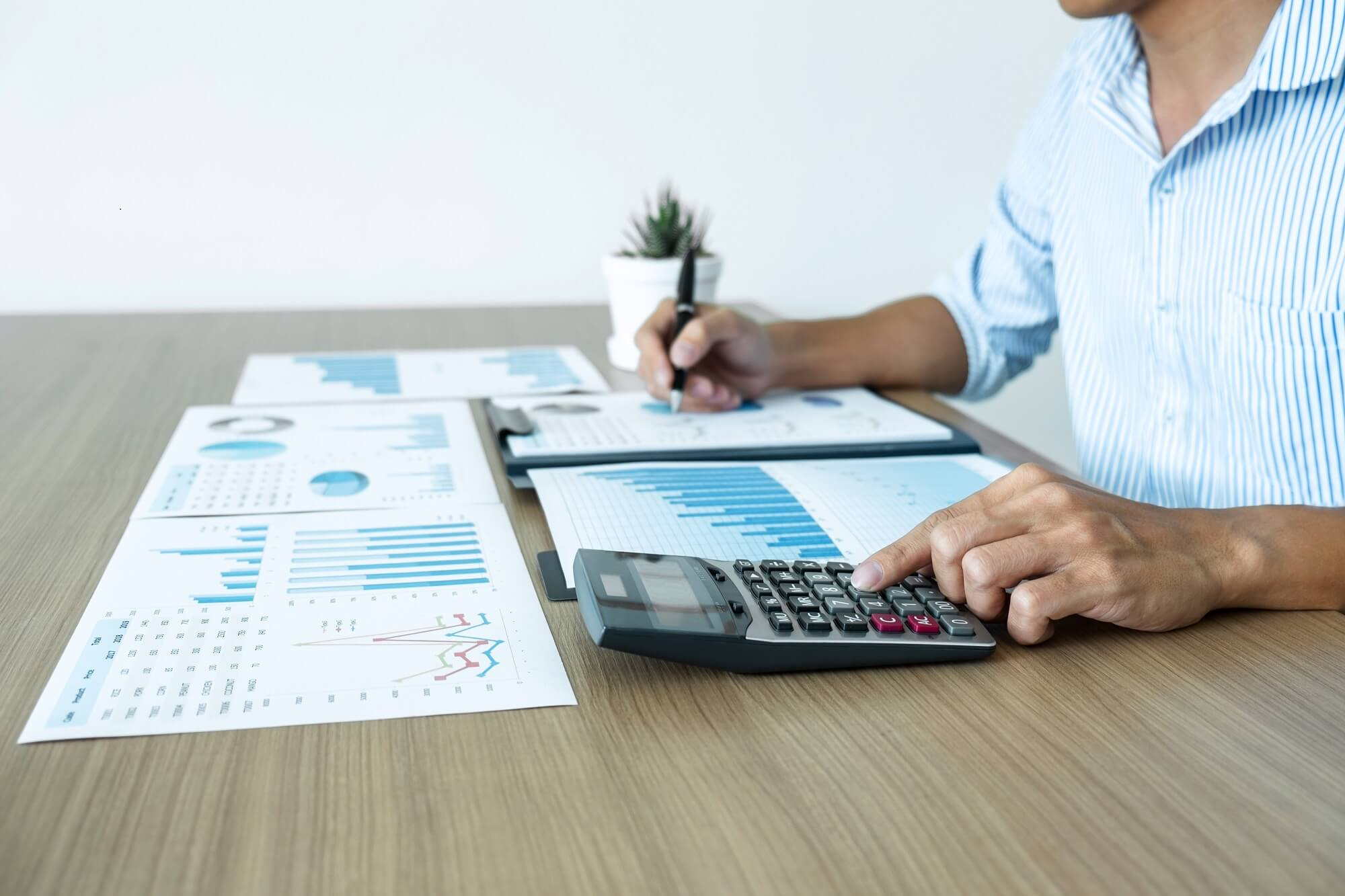 Businessman accountant making working audit and calculating expense financial annual financial report balance sheet statement