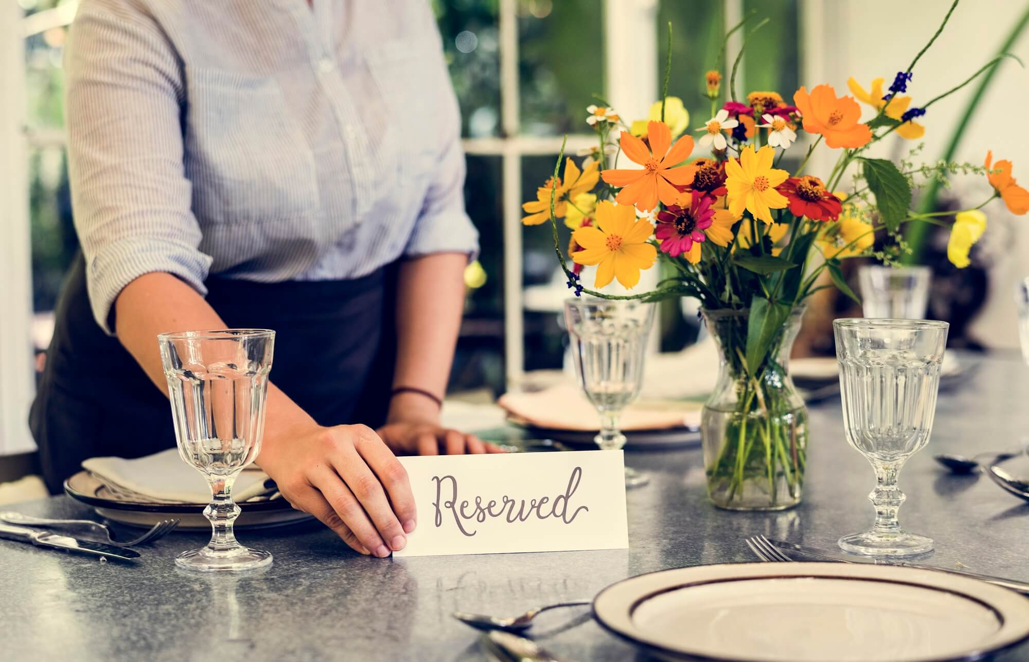 Caterers reserving table in cafe