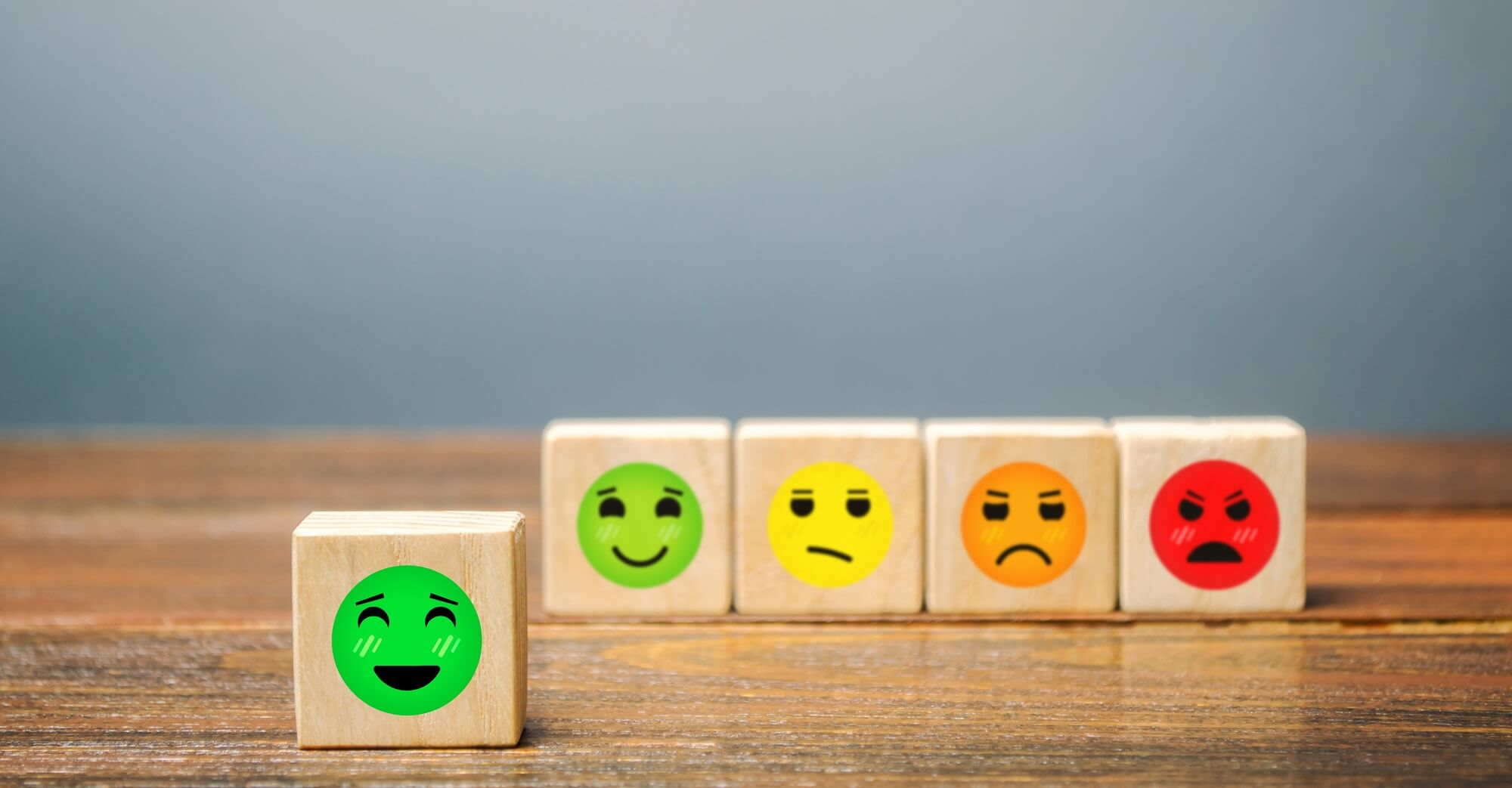 A series of blocks with faces from happy to angry.