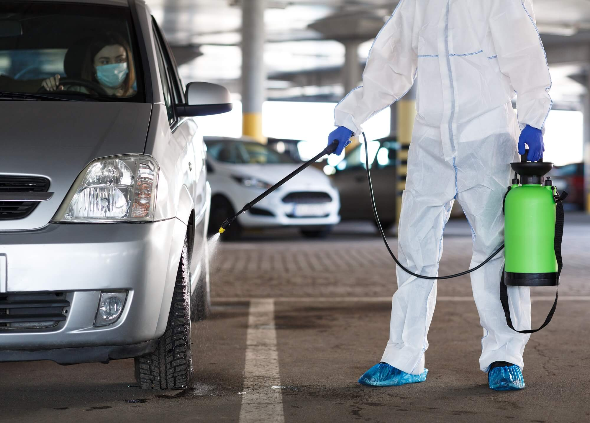 disinfecting car with spray