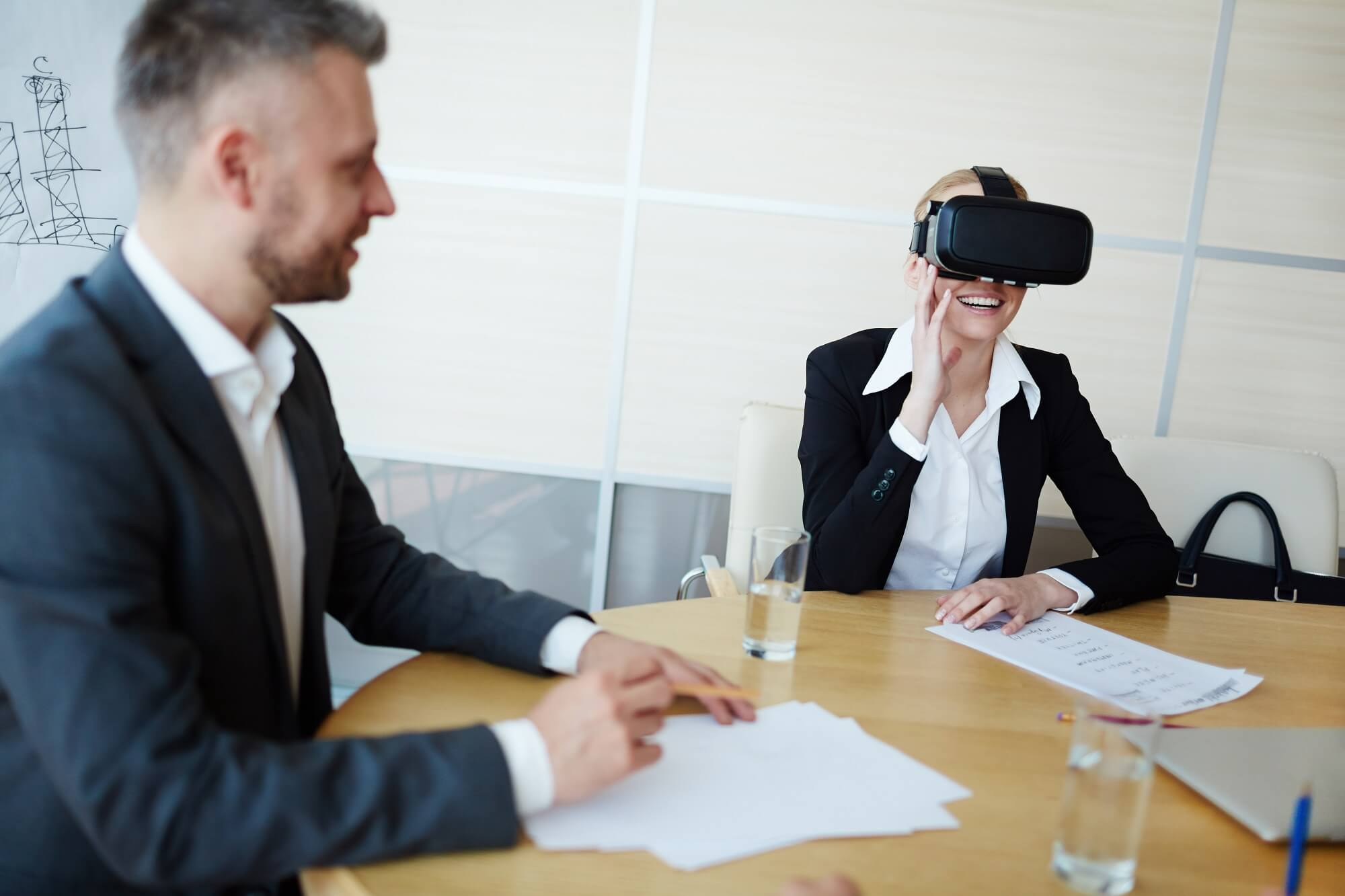 female client looking through corporate event with vr headset and doing virtual event planning