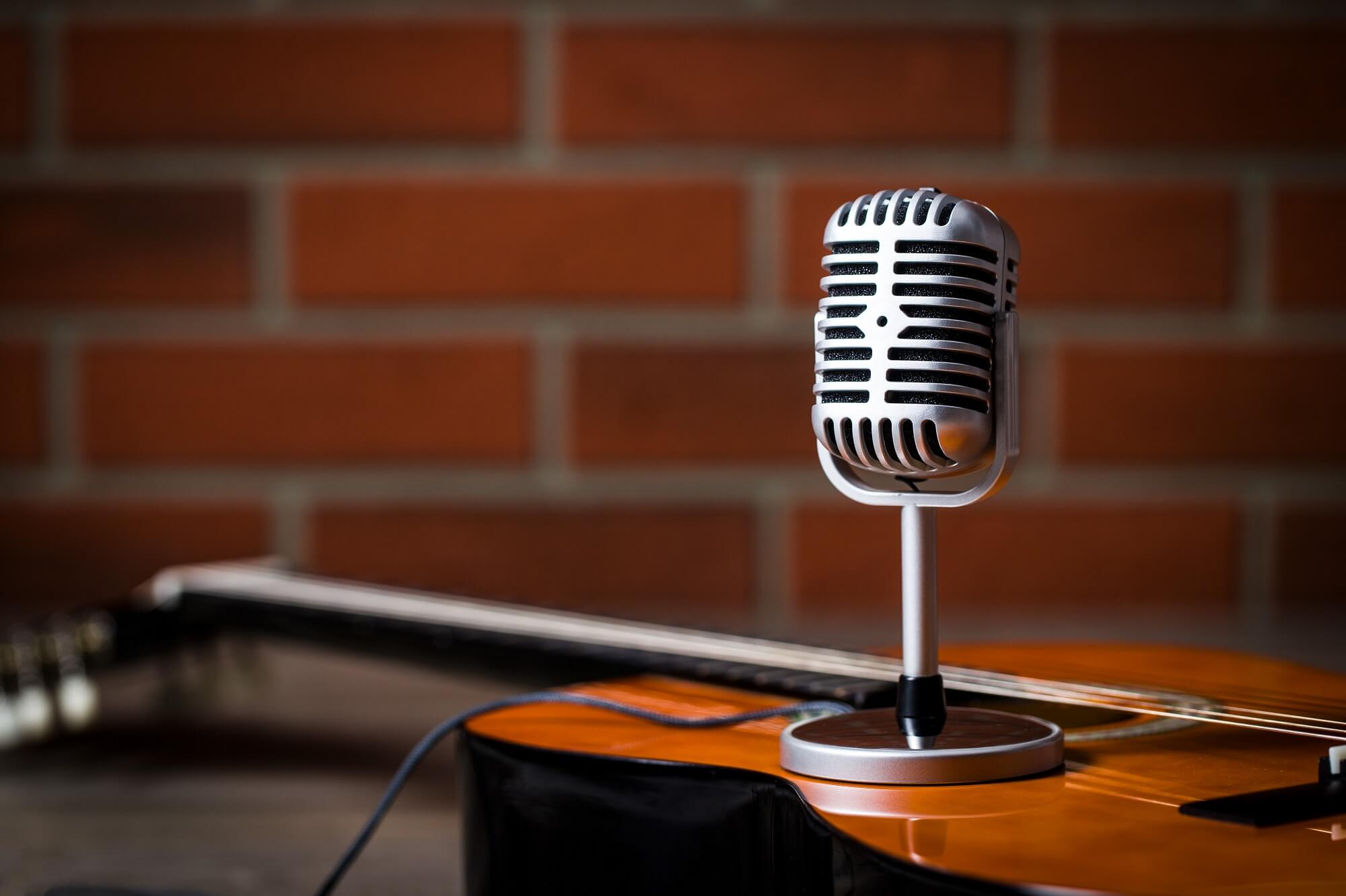 Vintage silver microphone and guitar recording for online singing course