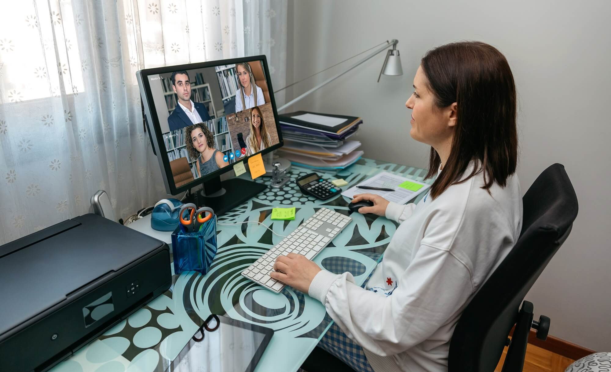 Woman having a virtual conference meeting from home and planning for virtual event