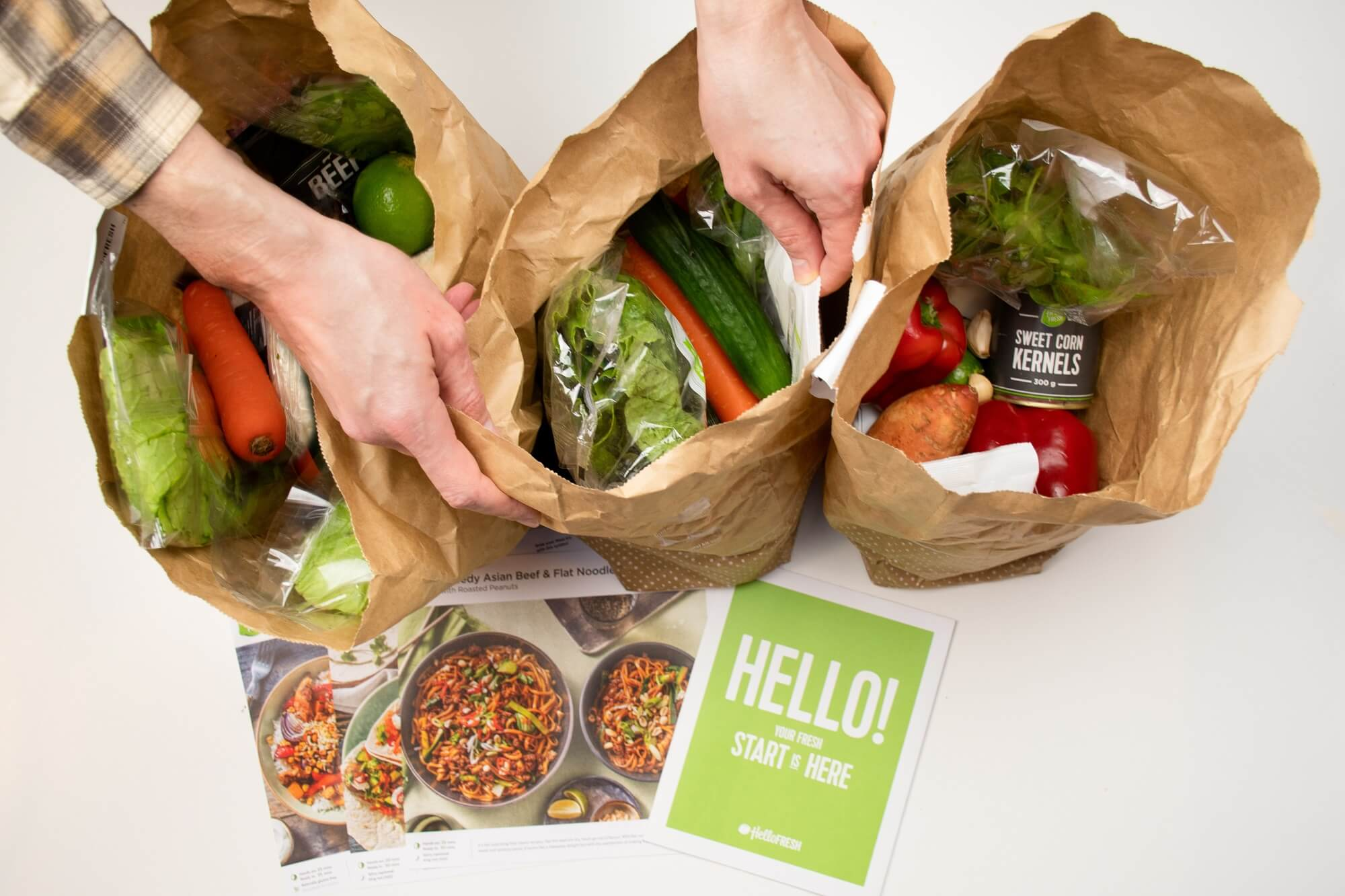 Hello Fresh meal kit raw ingredients in a paper bag