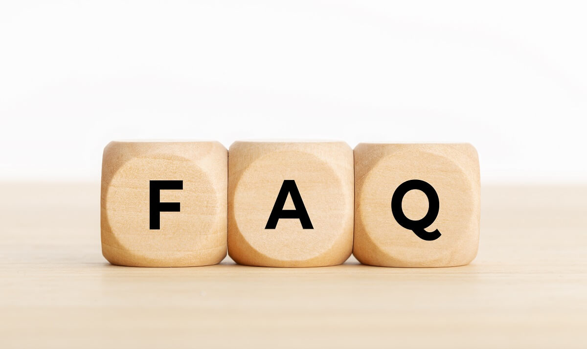 FAQ or frequently asked question concept. Wooden blocks with text on desk. Copy space