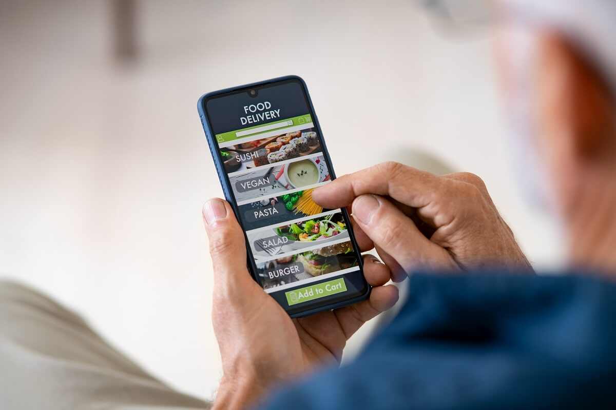 food delivery app with mobile phone to order lunch.