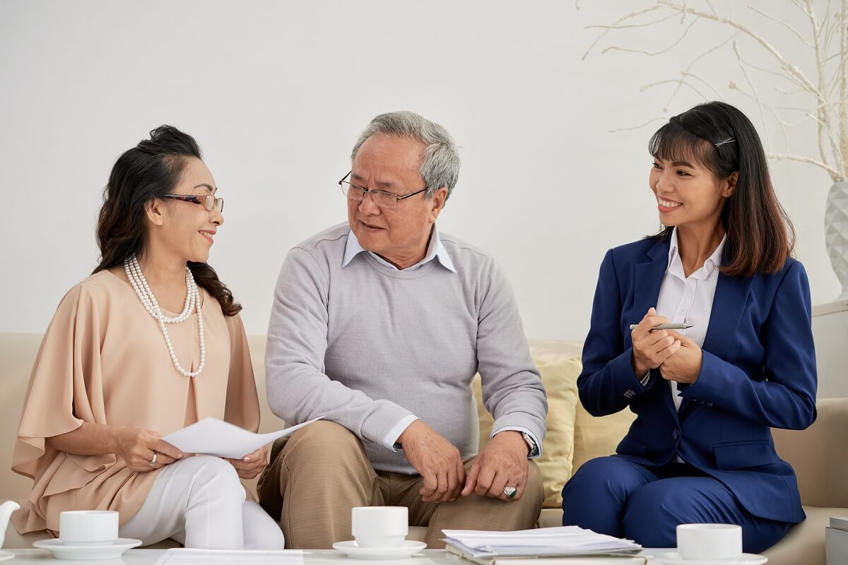 old couple meeting with financial adviser while choosing financial advisor