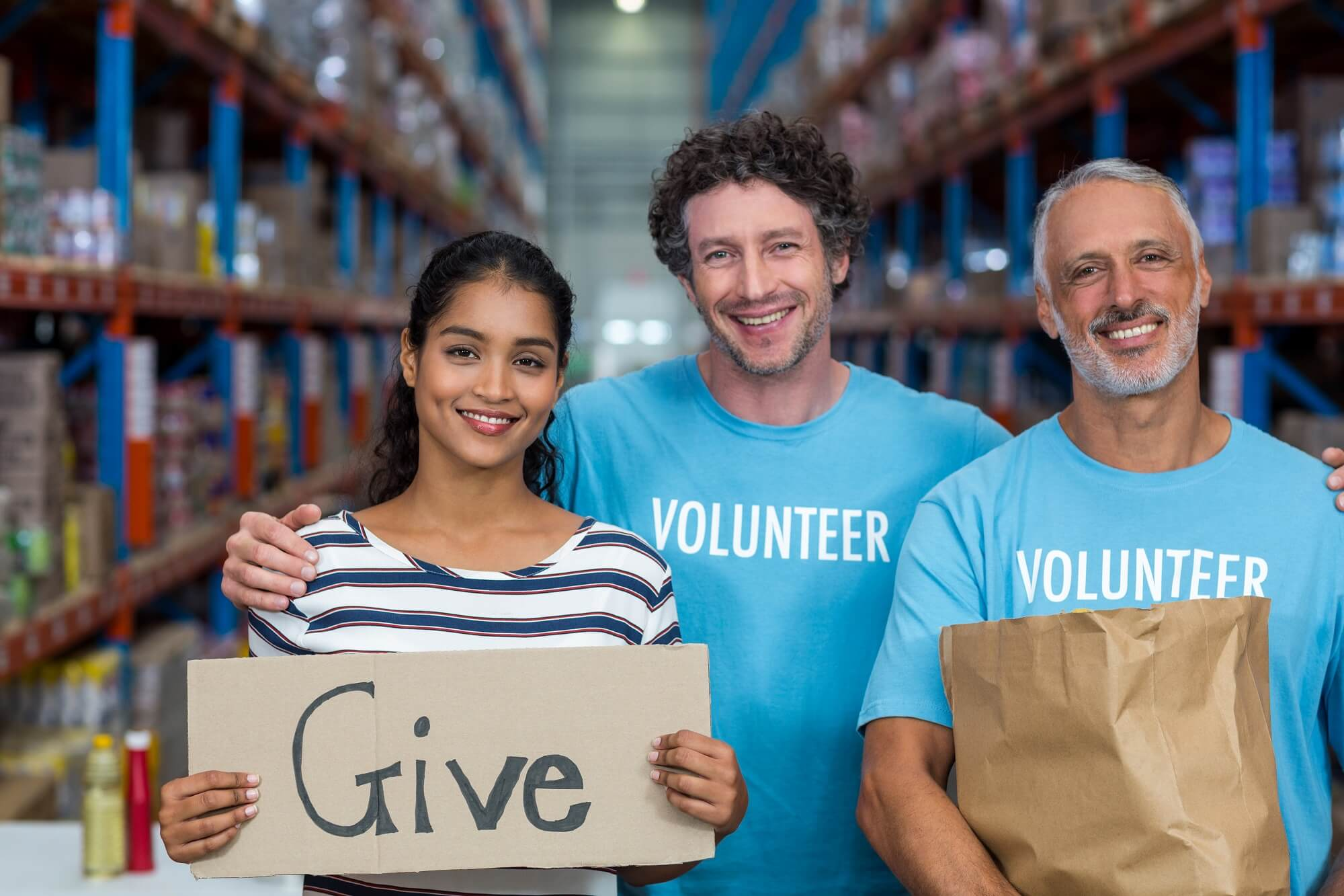 employees volunteering for charity happily