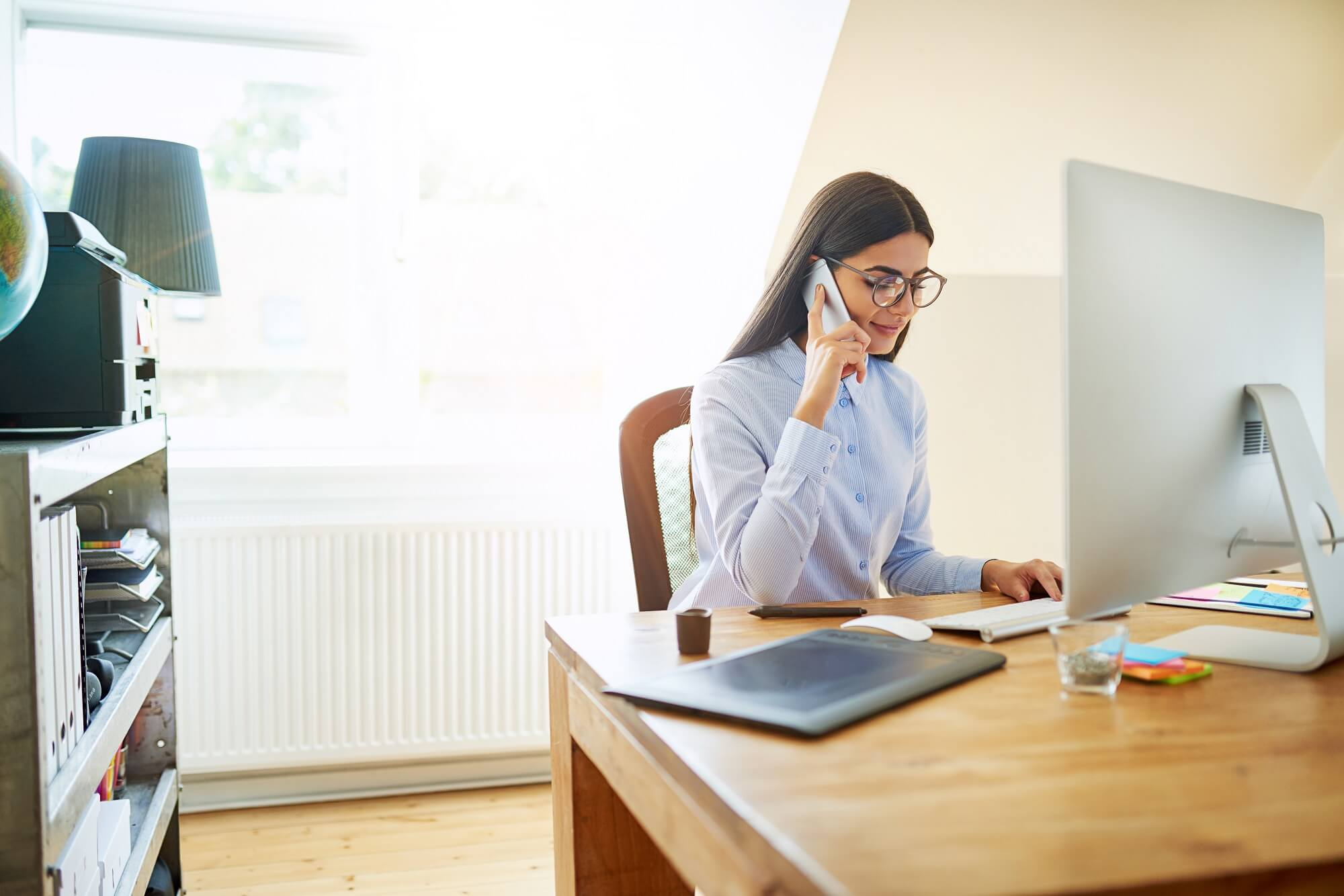 business owner at the desk on phone