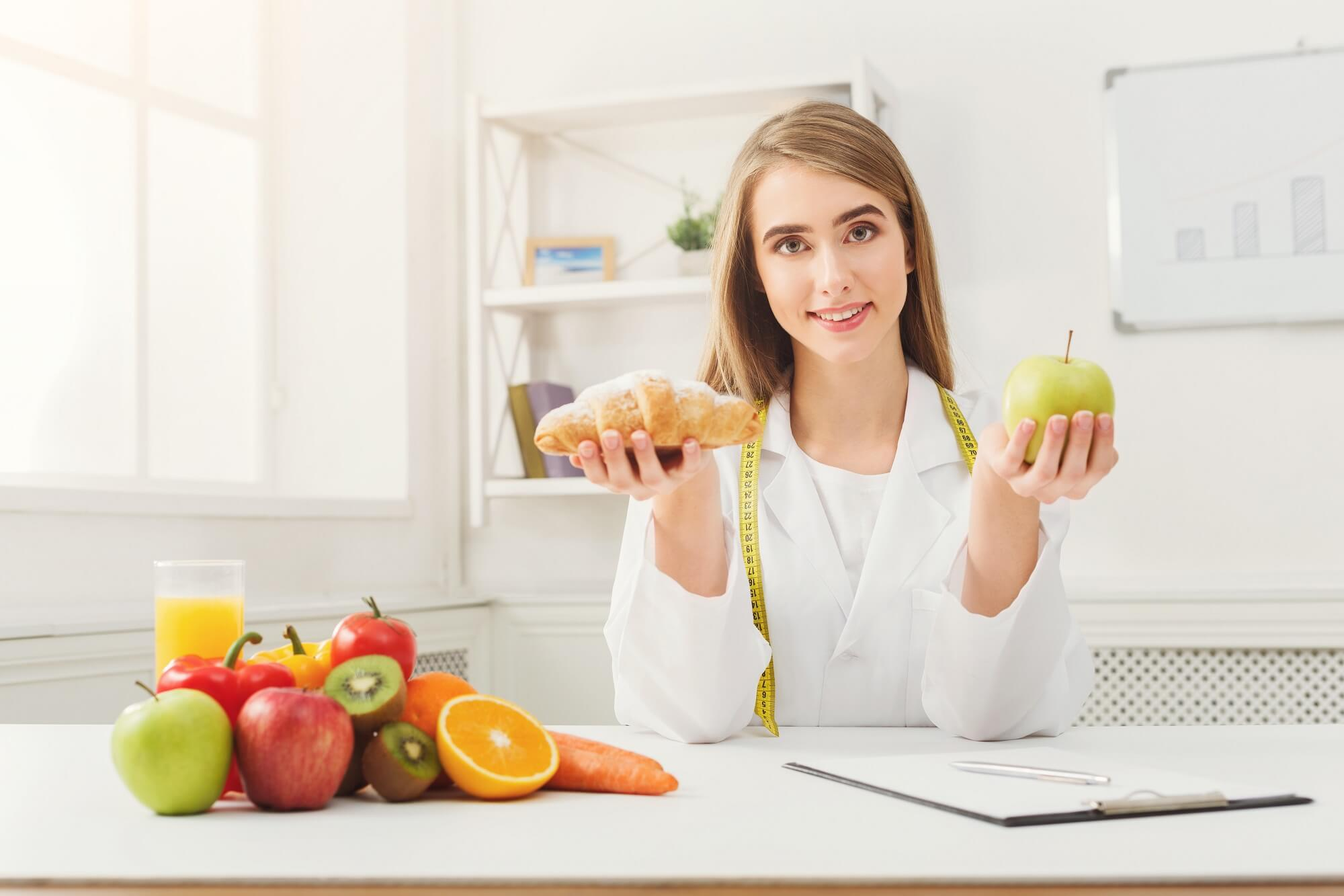 sports dietician comparing nutrition values of fruits and pastries