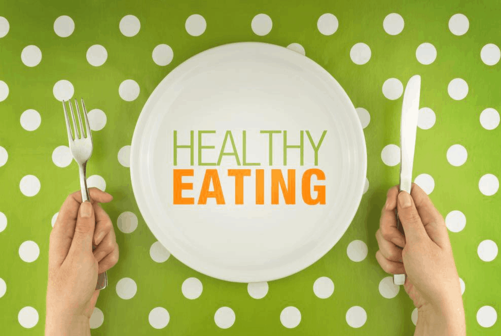 Hands with a knife and fork ready to eat healthy